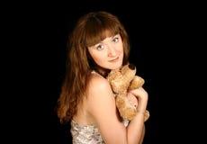 Menina doce bonita com um urso nas mãos Imagem de Stock