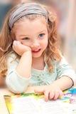 Menina doce com um livro Fotos de Stock Royalty Free