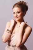Menina doce de sorriso com braceletes Imagens de Stock Royalty Free
