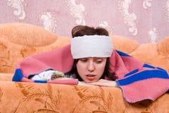 Menina doente em casa Imagens de Stock Royalty Free