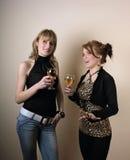 Menina dois que fala no partido Imagem de Stock Royalty Free