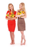 Menina dois que guarda frutos frescos Fotografia de Stock Royalty Free