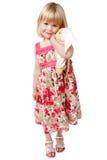 Menina dos anos de idade 4 que afaga uma peluche Imagens de Stock Royalty Free