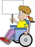 Menina dos desenhos animados em uma cadeira de rodas que guarda um sinal Imagens de Stock Royalty Free