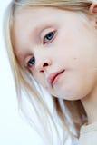 Menina dos olhos azuis Fotografia de Stock Royalty Free