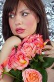 A menina e as rosas Fotos de Stock Royalty Free