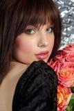 A menina e as rosas Imagens de Stock