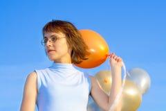 Menina e balões Fotos de Stock Royalty Free