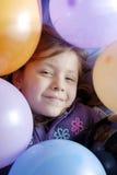 Menina e balões pequenos Imagem de Stock