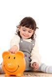 Menina e banco piggy Imagem de Stock