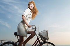Menina e bicicleta Imagem de Stock