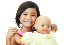 Menina e boneca Fotos de Stock
