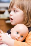 Menina e boneca Imagens de Stock Royalty Free