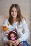 Menina e brinquedos Imagens de Stock Royalty Free