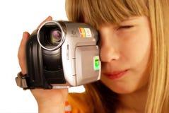 Menina e câmara de vídeo Fotos de Stock Royalty Free