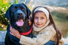 Menina e cão Imagem de Stock