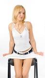 Menina e cadeira Fotografia de Stock