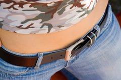 Menina e calças de brim Fotos de Stock Royalty Free