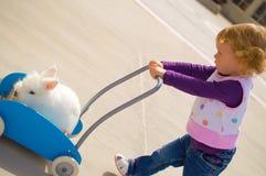 Menina e coelho Imagens de Stock