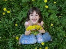 Menina e dente-de-leão Fotografia de Stock