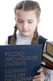 Menina e dicionário russo-inglês Foto de Stock Royalty Free
