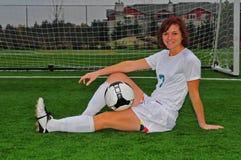 Menina e esfera do futebol fotos de stock