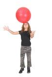 Menina e esfera vermelha grande Fotos de Stock