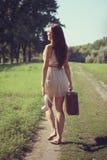 Menina e estrada. Fotos de Stock