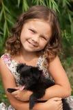 Menina e filhote de cachorro Fotos de Stock Royalty Free