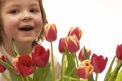 menina e flores imagem de stock royalty free