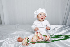 Menina e flores Imagens de Stock