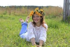Menina e flores agradáveis Imagens de Stock Royalty Free