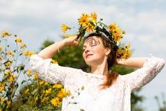 Menina e flores agradáveis Imagens de Stock