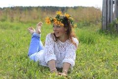 Menina e flores agradáveis Fotos de Stock