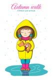Menina e gatinho na chuva Foto de Stock