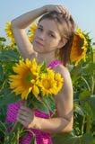 Menina e girassóis Imagem de Stock