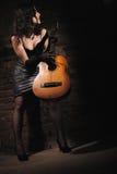 Menina e guitarra Imagens de Stock Royalty Free