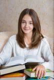 Menina e livros Fotos de Stock