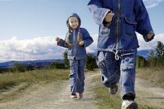 Menina e menino Fotografia de Stock