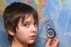 A menina e o compasso Fotos de Stock