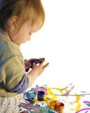 Menina e pinturas pequenas Imagens de Stock Royalty Free