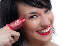 Menina e preservativo isolados no branco Imagens de Stock Royalty Free