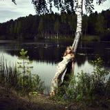 Menina e rio Imagens de Stock