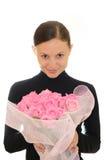 Menina e rosas cor-de-rosa imagem de stock