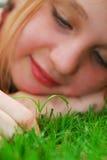 Menina e seedling Fotografia de Stock