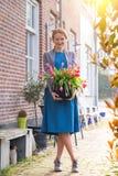 Menina e tulipas fotografia de stock royalty free