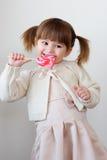 Menina e um lollipop Fotos de Stock