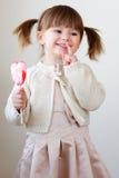 Menina e um lollipop Imagem de Stock Royalty Free