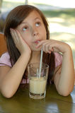 Menina e uma bebida Fotografia de Stock