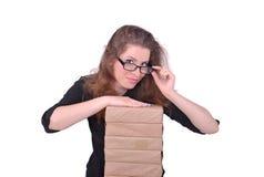 Menina e uma pilha de papel Fotos de Stock